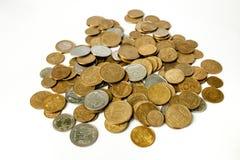 Bakgrund av guld- mynt arkivfoto