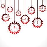 Bakgrund av hängande röda klockor för kugghjulform Arkivbild