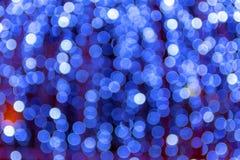 Bakgrund av inte skarpa blåa ljusa kulor royaltyfria foton