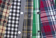Bakgrund av mäns rutiga skjortor Arkivbilder