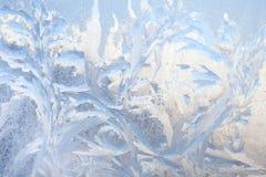 Bakgrund av målning på det djupfryst fönstret vid frost - ingen Arkivbild