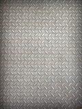 Bakgrund av metalldiamantplattan Arkivfoto