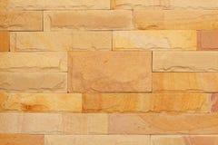 Bakgrund av modern textur för stentegelstenvägg, den abstrakta sandväggen eller granitväggen Arkivfoton