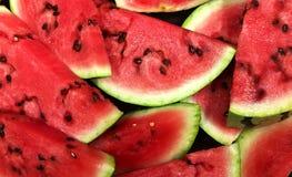 Bakgrund av nya mogna vattenmelonskivor Royaltyfri Fotografi