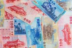 Bakgrund av nya Taiwan dollar 1000, 500 och 100 Royaltyfria Bilder