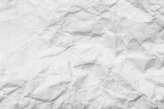 Bakgrund av pappers- skrynklig vit Arkivfoto