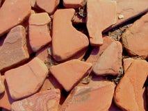 Bakgrund av röda stenar Arkivbild