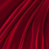 Bakgrund av rött skinande silke Arkivfoton