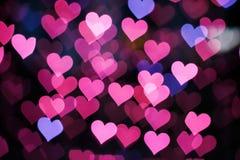 Bakgrund av rosa hjärtor Arkivbilder