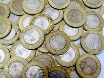 Bakgrund av 10 rupier indiskt mynt Arkivbilder