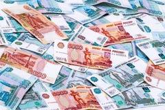 Bakgrund av ryska pappers- pengar Fotografering för Bildbyråer