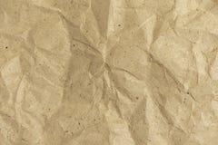 Bakgrund av skrynkligt inpackningspapper Rufsad till pappers- textur royaltyfri foto