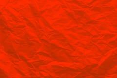 Bakgrund av skrynkligt rött papper Arkivbild
