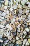 Bakgrund av små stenar Arkivbilder