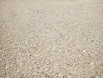 Bakgrund av stenar, grusväg Arkivfoto
