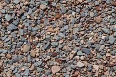 Bakgrund av stenar och kiselstenar, textur Arkivbild
