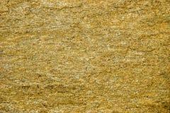 Bakgrund av stenen med guld- fläckar Stenen vaggar med guld- partiklar Royaltyfria Bilder