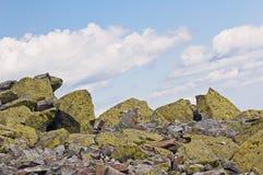 Bakgrund av stenen naturlig sten Berg Arkivfoto