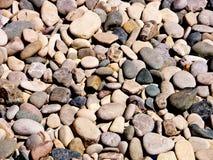 Bakgrund av strandpebbles Royaltyfria Bilder