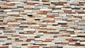 Bakgrund av väggen för tappningfärgtegelsten Arkivbilder