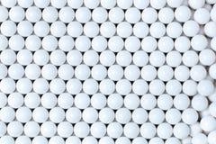 Bakgrund av vita bollar airsoft 6mm Arkivfoto