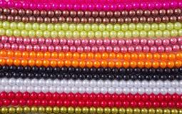 bakgrund beads färgrik marmor Arkivfoton