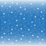 Bakgrund - blå himmel med snöflingor Arkivfoton