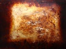bakgrund bränd metallplatta Fotografering för Bildbyråer