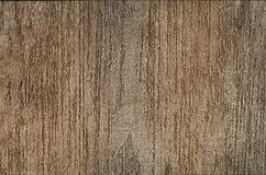 Bakgrund - brun murbruk i band, dekorativ beläggning royaltyfria foton