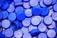bakgrund caps plast- Royaltyfri Foto