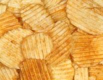 bakgrund chips potatisen Royaltyfri Bild