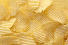bakgrund chips potatisen Fotografering för Bildbyråer