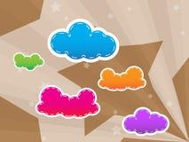 bakgrund clouds den färgrika designstjärnan Arkivbilder