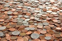 bakgrund coins monay Arkivbilder