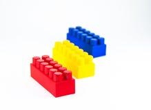bakgrund 3d blockerar plastic toywhite för färgrik bild Arkivbild
