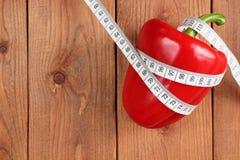 Bakgrund diet-röd peppar Arkivbild