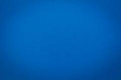 Bakgrund eller gammalt papper A4 för Abtract pappersblått Arkivfoto