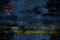 Bakgrund eller textur för mörk grunge wood med att blanda den Aruba flaggan Royaltyfria Foton