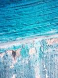Bakgrund - en gammal vägg med en blå målarfärg Fotografering för Bildbyråer