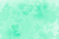 Bakgrund för abstrakt begrepp för dag för valentin` s av mjuka gröna hjärtor för mintkaramellbokehsuddighet Arkivfoto