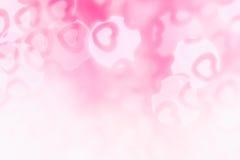 Bakgrund för abstrakt begrepp för dag för valentin` s av mjuka rosa färger, vita bokehsuddighetshjärtor Royaltyfria Foton