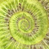 Bakgrund för abstrakt begrepp för kiwioändlighetsspiral. Arkivbilder
