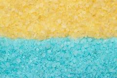 Bakgrund för aromatiskt bad för blått och för guling salt Arkivbilder