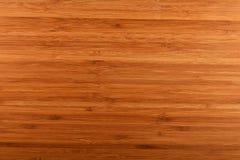 Bakgrund för bambuträbitande kökbräde Arkivbild