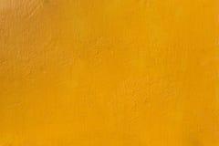 Bakgrund för betongvägggulingtextur Arkivbild