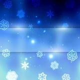 Bakgrund för blått för nytt år suddig med snöflingor Arkivfoton