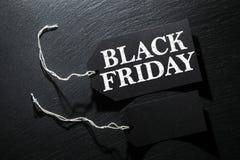Bakgrund för Black Friday försäljningsetikett royaltyfri fotografi
