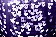 Bakgrund för bokeh för hjärtaform mousserar suddig med Ultraviolett Arkivfoto