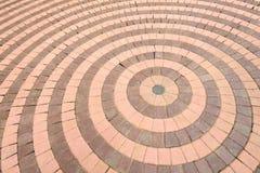 Bakgrund för cirkeltegelstenvägg Arkivbild