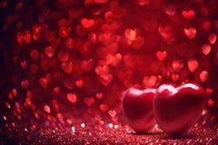 Bakgrund för dag för valentin` s Blänka effekt med röda Bokeh royaltyfria bilder